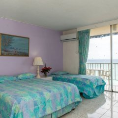 Отель Blue Lagoon Beach Studio At Montego Club Resort Ямайка, Монтего-Бей - отзывы, цены и фото номеров - забронировать отель Blue Lagoon Beach Studio At Montego Club Resort онлайн комната для гостей фото 2