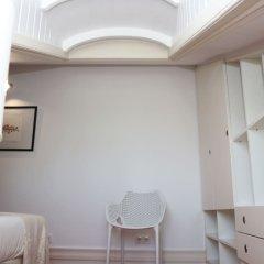Отель Botanic Views Guest House Лиссабон в номере