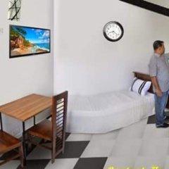 Отель Omega Hotel & Motel Шри-Ланка, Коломбо - отзывы, цены и фото номеров - забронировать отель Omega Hotel & Motel онлайн комната для гостей