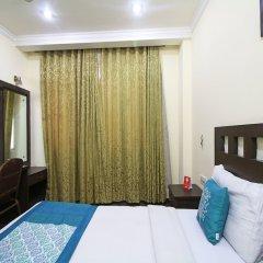 Отель OYO 5943 TJS Grand комната для гостей фото 3