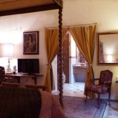 La Perla Hotel Boutique B&B удобства в номере