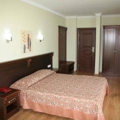 Alkan Hotel комната для гостей