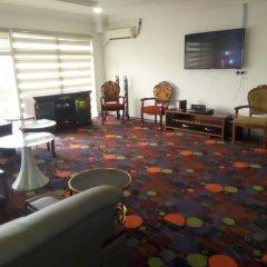Отель Golden Tulip Airport Hotel Нигерия, Варри - отзывы, цены и фото номеров - забронировать отель Golden Tulip Airport Hotel онлайн интерьер отеля фото 2