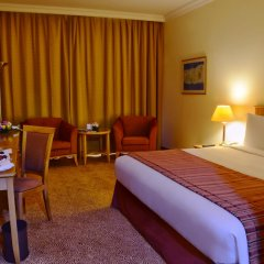 Отель Swiss-Belhotel Sharjah комната для гостей фото 5