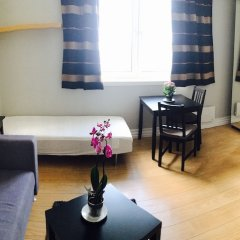 Апартаменты Kristiansand Apartments Кристиансанд комната для гостей фото 5