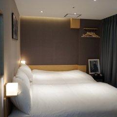 Отель Artravel Myeongdong Южная Корея, Сеул - отзывы, цены и фото номеров - забронировать отель Artravel Myeongdong онлайн комната для гостей фото 2
