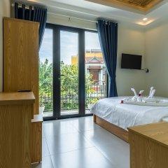 Отель Ngo Homestay Хойан сейф в номере