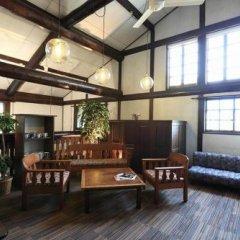 Отель Lodge Karunaju & The Alpine Grill Хакуба интерьер отеля