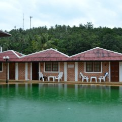 Отель The Kata Resort бассейн