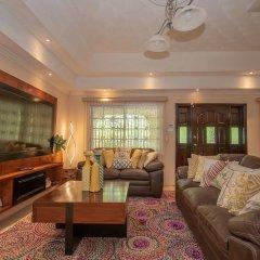 Отель Tropical Escape Villa - 3 Bedroom Ямайка, Монастырь - отзывы, цены и фото номеров - забронировать отель Tropical Escape Villa - 3 Bedroom онлайн комната для гостей фото 3