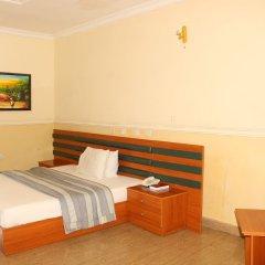 Отель Xcape Hotels and Suites Ltd Нигерия, Калабар - отзывы, цены и фото номеров - забронировать отель Xcape Hotels and Suites Ltd онлайн сейф в номере