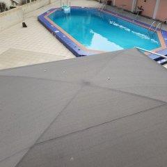 Отель Peemos Place Warri бассейн