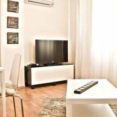 Апартаменты Cozy Flats Defne Apartment Стамбул комната для гостей фото 2