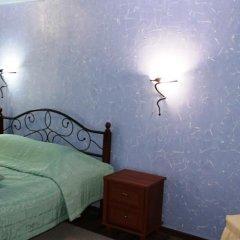 Гостиница Мини-Отель Атриум в Кургане отзывы, цены и фото номеров - забронировать гостиницу Мини-Отель Атриум онлайн Курган комната для гостей фото 3
