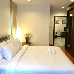 Отель 14 Place Sukhumvit Suites Бангкок комната для гостей фото 4