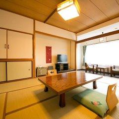 Отель Kinosato Yamanoyu Япония, Минамиогуни - отзывы, цены и фото номеров - забронировать отель Kinosato Yamanoyu онлайн комната для гостей фото 3
