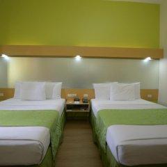 Отель Microtel Inn And Suites Davao Филиппины, Давао - отзывы, цены и фото номеров - забронировать отель Microtel Inn And Suites Davao онлайн комната для гостей фото 5