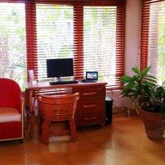 Отель Idle Awhile Resort Ямайка, Саванна-Ла-Мар - отзывы, цены и фото номеров - забронировать отель Idle Awhile Resort онлайн интерьер отеля фото 3