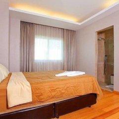 Апартаменты Ocean Fringe Apartment A Паттайя комната для гостей фото 3