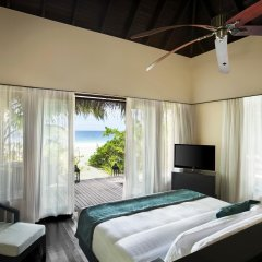 Отель Outrigger Konotta Maldives Resort комната для гостей