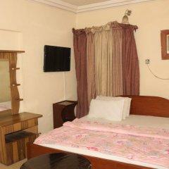 Отель Bv.Standard Executive Suite Нигерия, Калабар - отзывы, цены и фото номеров - забронировать отель Bv.Standard Executive Suite онлайн сейф в номере