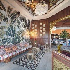 Отель Grand Bahia Principe Aquamarine Доминикана, Пунта Кана - отзывы, цены и фото номеров - забронировать отель Grand Bahia Principe Aquamarine онлайн интерьер отеля