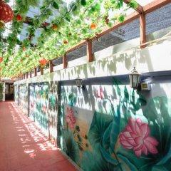 Отель Chinese Culture Holiday Hotel - Nanluoguxiang Китай, Пекин - отзывы, цены и фото номеров - забронировать отель Chinese Culture Holiday Hotel - Nanluoguxiang онлайн балкон