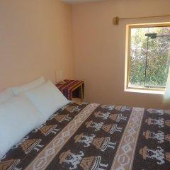 Отель Titicaca Lodge - Isla Amantani Перу, Тилилака - отзывы, цены и фото номеров - забронировать отель Titicaca Lodge - Isla Amantani онлайн комната для гостей