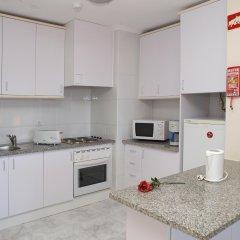 Отель Apartamentos Turisticos Jardins Da Rocha в номере