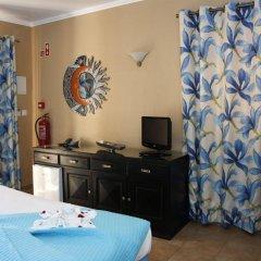 Отель Montinho De Ouro удобства в номере