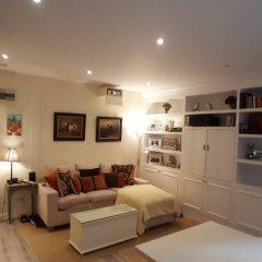 Отель Cosy Central 1 Bedroom Flat With Shared Roof Terrace & Gym Лондон фото 2