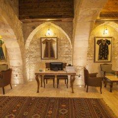 Отель Kayakapi Premium Caves Cappadocia интерьер отеля фото 3