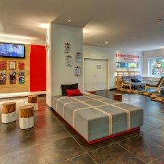 Отель MEININGER Hotel Hamburg City Center Германия, Гамбург - отзывы, цены и фото номеров - забронировать отель MEININGER Hotel Hamburg City Center онлайн интерьер отеля