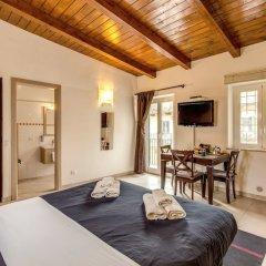 Апартаменты Aurelia Vatican Apartments комната для гостей фото 7