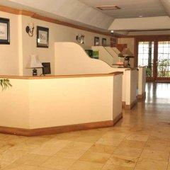 Отель The Wexford Hotel Montego Bay Ямайка, Монтего-Бей - отзывы, цены и фото номеров - забронировать отель The Wexford Hotel Montego Bay онлайн интерьер отеля