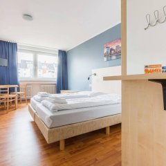 Отель a&o Düsseldorf Hauptbahnhof Германия, Дюссельдорф - 6 отзывов об отеле, цены и фото номеров - забронировать отель a&o Düsseldorf Hauptbahnhof онлайн комната для гостей фото 5