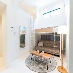 Отель Trip Pod Takasago A Фукуока комната для гостей