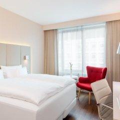Отель NH Collection Frankfurt City 4* Стандартный номер с различными типами кроватей фото 4