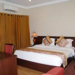 Отель Grand Inn & Suites комната для гостей фото 2