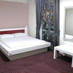 Отель Grand Saranda Албания, Саранда - отзывы, цены и фото номеров - забронировать отель Grand Saranda онлайн комната для гостей фото 4