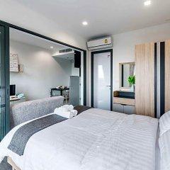 Отель The Rich Condo By Favstay комната для гостей