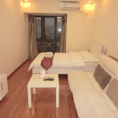 Отель Shengang Apartment Shenzhen Yuhedi Branch Китай, Шэньчжэнь - отзывы, цены и фото номеров - забронировать отель Shengang Apartment Shenzhen Yuhedi Branch онлайн комната для гостей фото 3