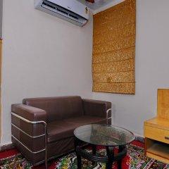 Отель OYO 5943 TJS Grand комната для гостей
