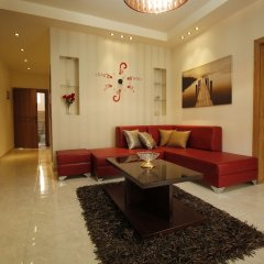 Отель Aqarco Shmaisani Apartment Иордания, Амман - отзывы, цены и фото номеров - забронировать отель Aqarco Shmaisani Apartment онлайн интерьер отеля