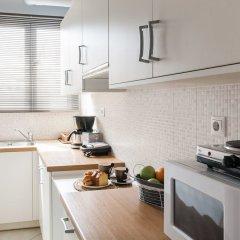 Апартаменты Syntagma Square Luxury Apartment Афины в номере