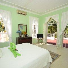 Отель Summerhill, 8BR by Jamaican Treasures Ямайка, Монтего-Бей - отзывы, цены и фото номеров - забронировать отель Summerhill, 8BR by Jamaican Treasures онлайн комната для гостей фото 2