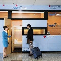 Отель VATC SleepPod Terminal 2 банкомат