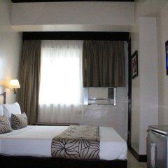 Отель Palm Grove Hotel Филиппины, Манила - отзывы, цены и фото номеров - забронировать отель Palm Grove Hotel онлайн комната для гостей
