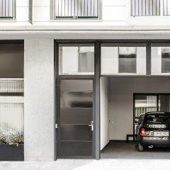 Отель Eric Vökel Boutique Apartments - Atocha Suites Испания, Мадрид - отзывы, цены и фото номеров - забронировать отель Eric Vökel Boutique Apartments - Atocha Suites онлайн парковка