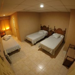Отель Hostal La Casa de Enfrente комната для гостей
